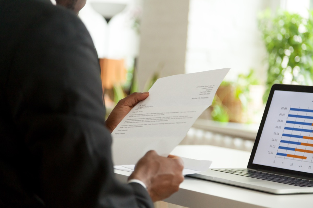 cover letter in manager's hands, hiring manager tips