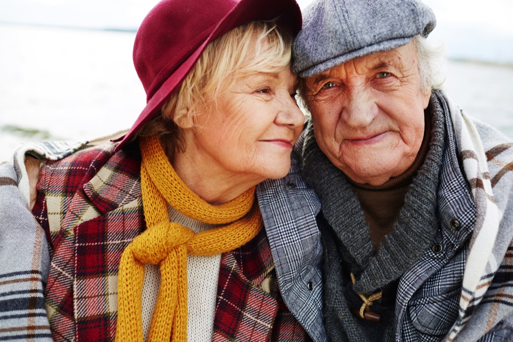 elderly couple in hats