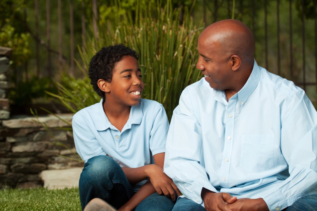 Black father and son talking