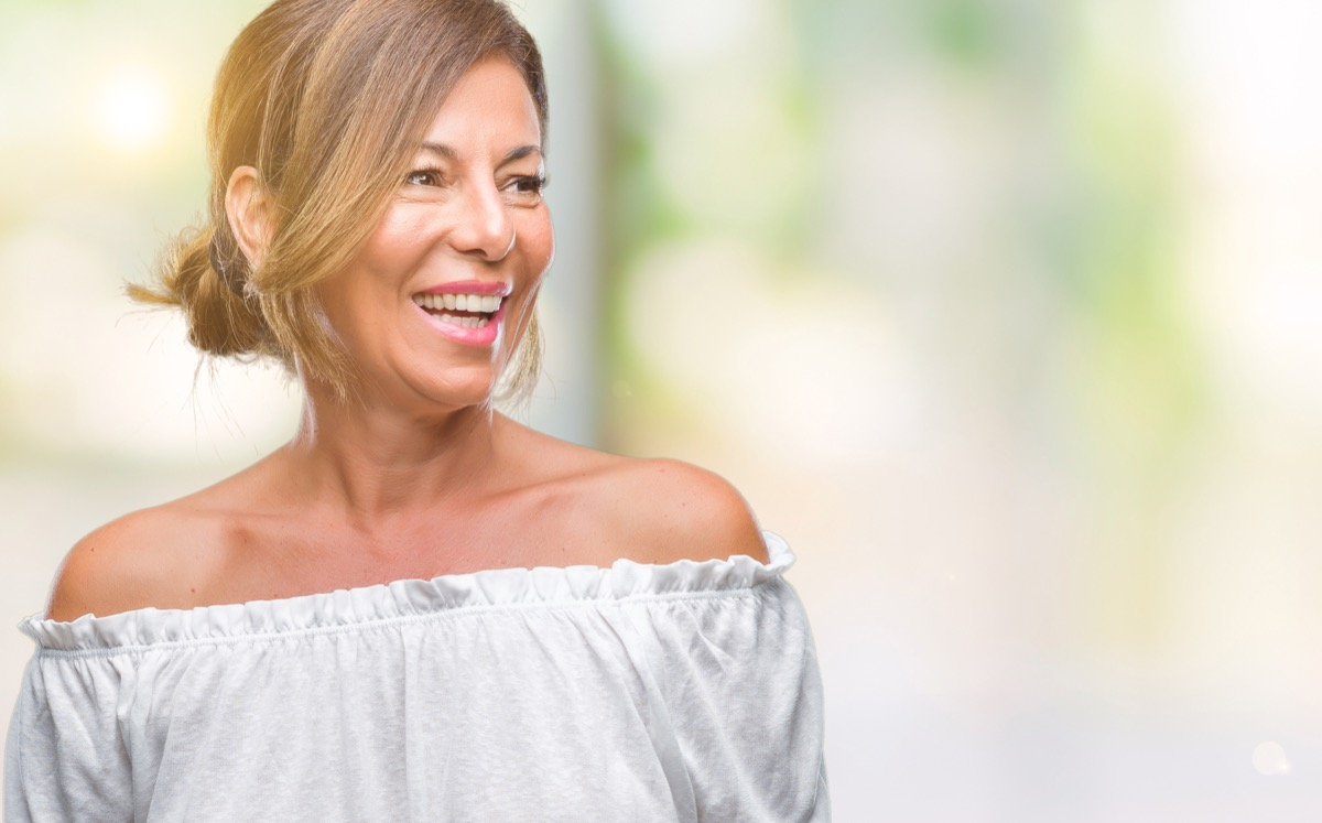 Middle age woman glowing smiling