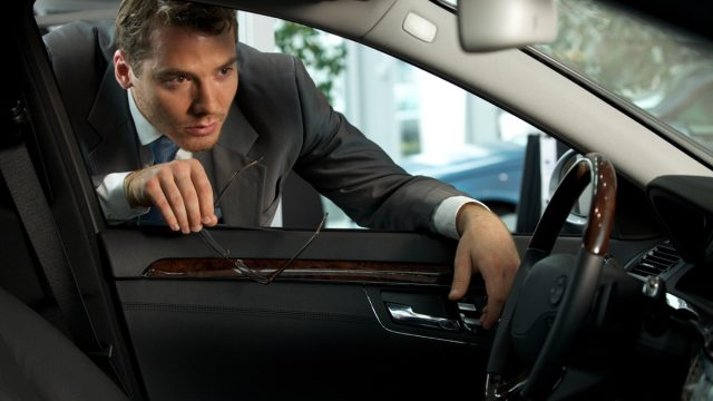 Man inspecting new car things burglars know