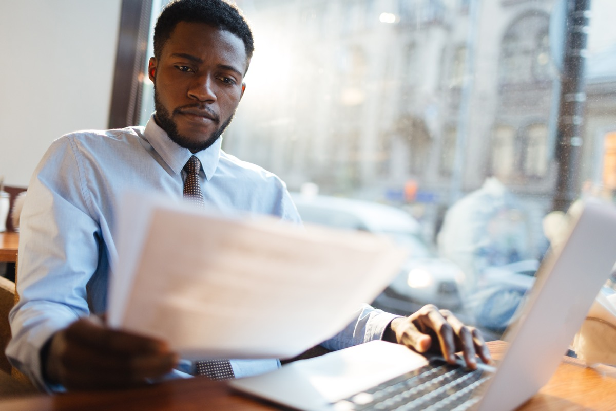 man looking over someone's resume, hiring manager tips