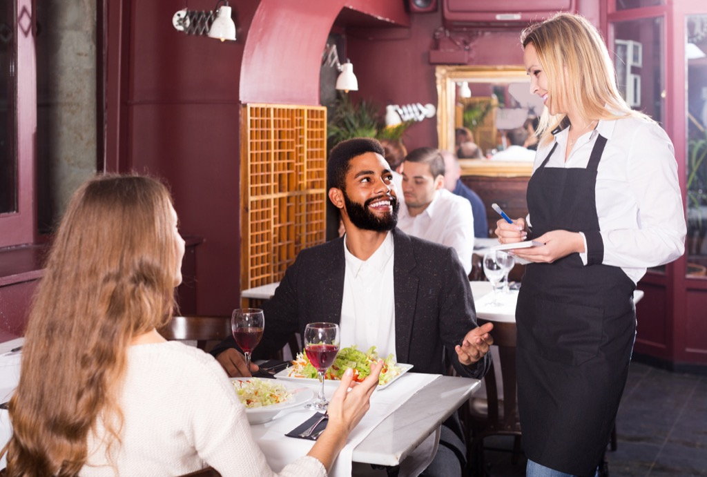 man talking to his waitress