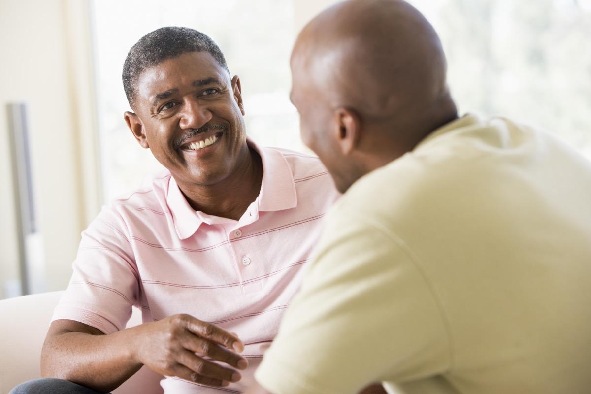 Middle age black men talking smiling