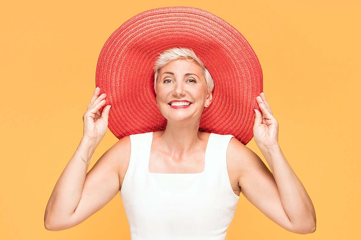 Middle aged woman in big colorful sun hat