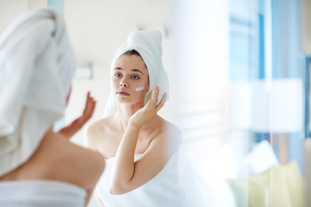 moisturizer woman towel bathroom