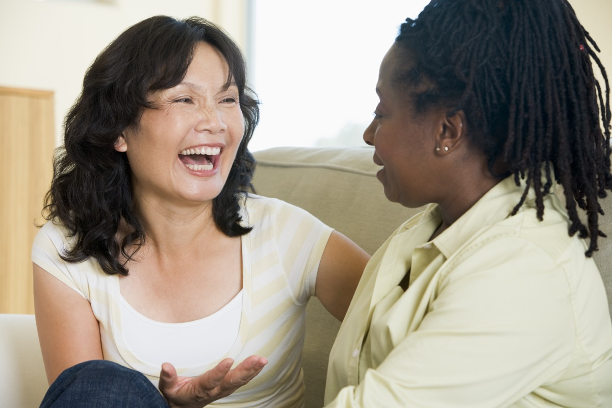 Multicultural women talking and laughing