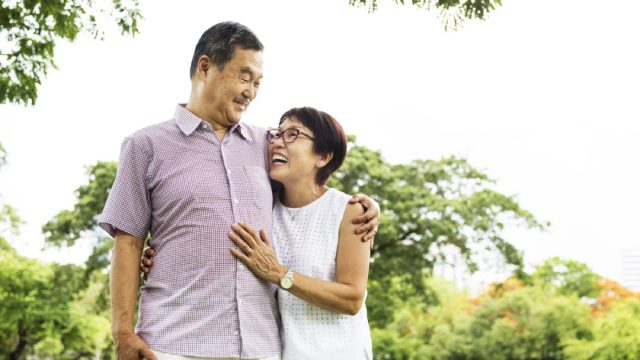 older couple walking outdoors, long marriage tips