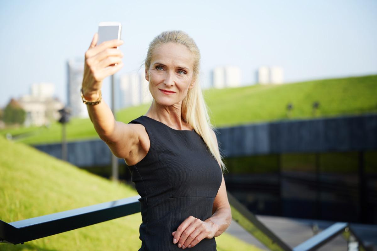 Confident older woman taking a selfie