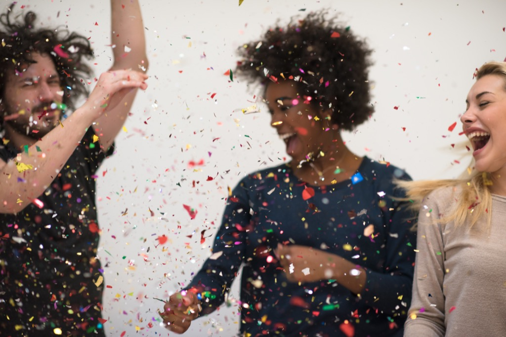 people dancing with confetti