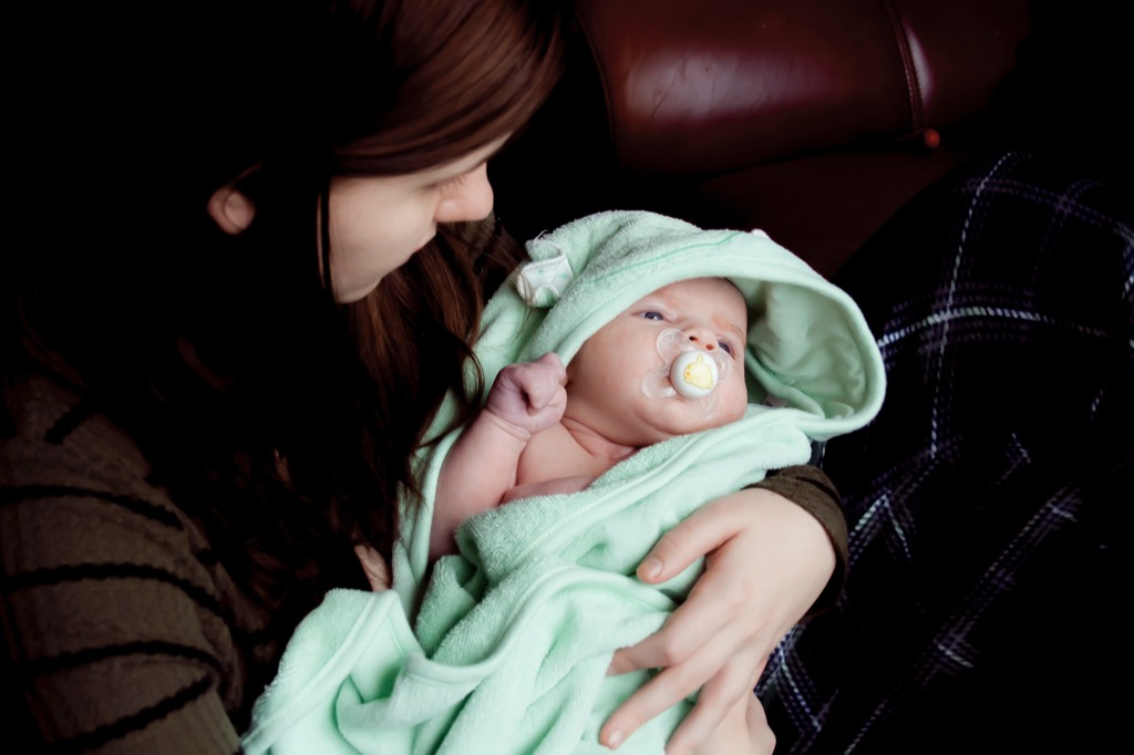 Woman holding a baby in a blanket