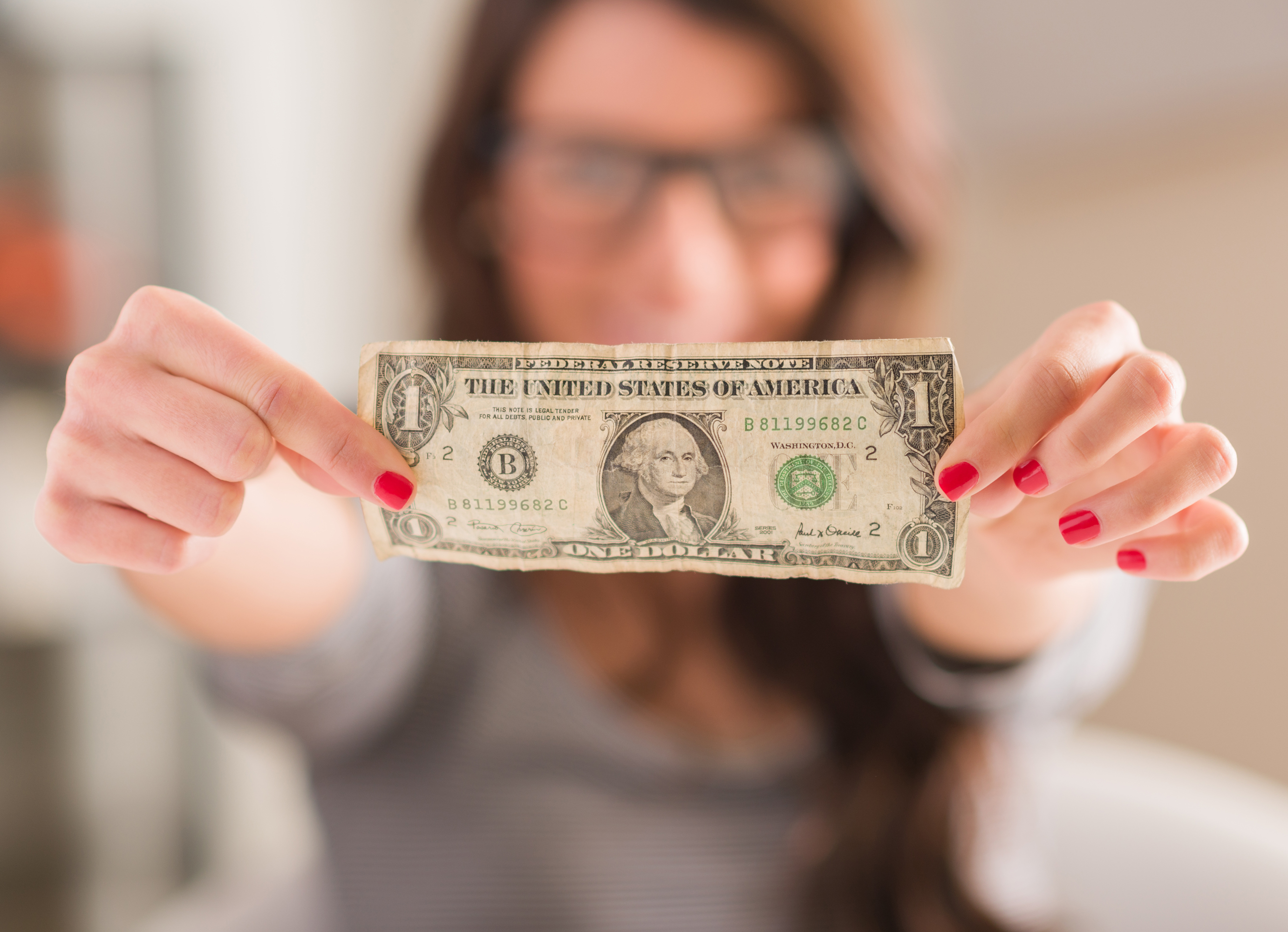 girl with dollar bill, crazy facts about dollar bills