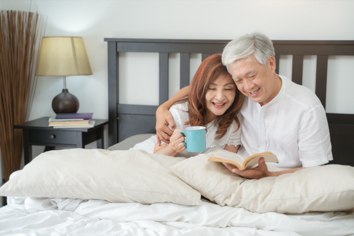 couple reading a book in bed