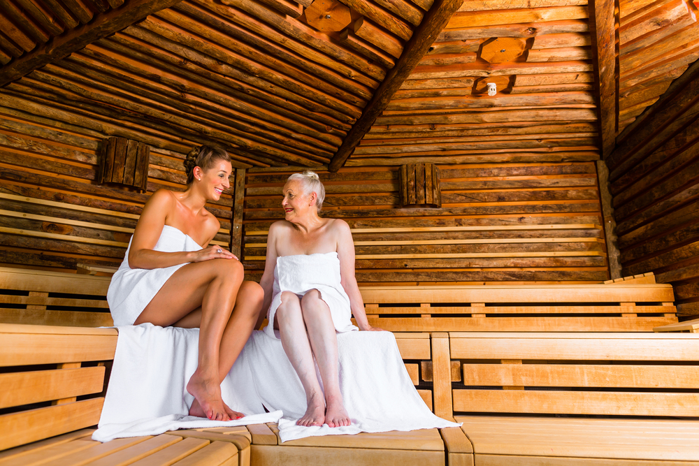 old and young woman in sauna