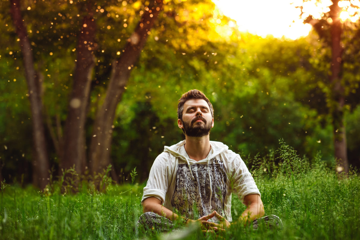 Man Meditating Outside