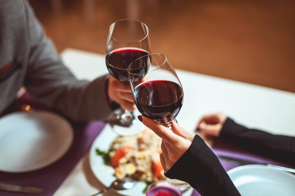 people drinking wine at dinner habits that increase your risk of a stroke