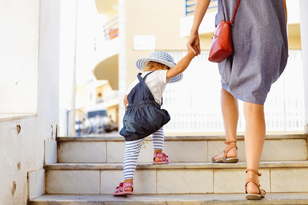 babysitter walking with toddler, ways parenting has changed