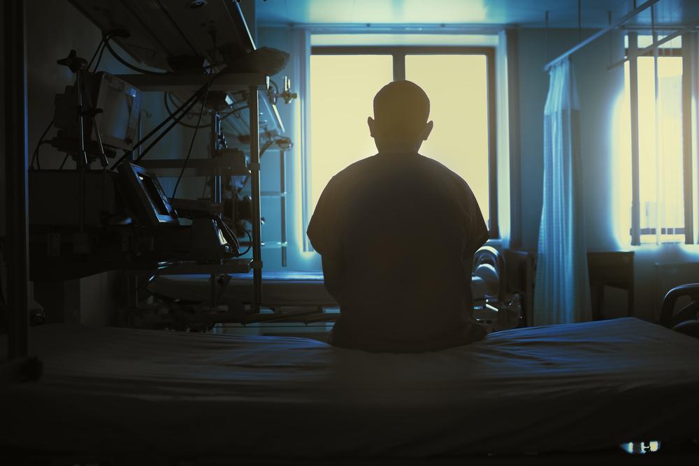 man sitting alone in hospital.