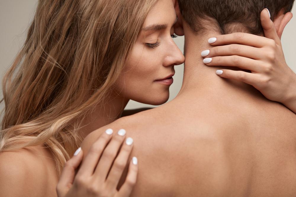 woman smelling man