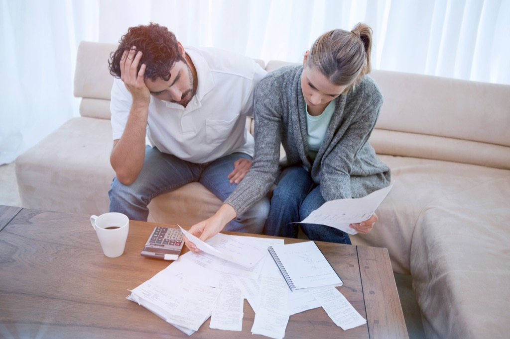 Unhappy Couple Budgeting regrets