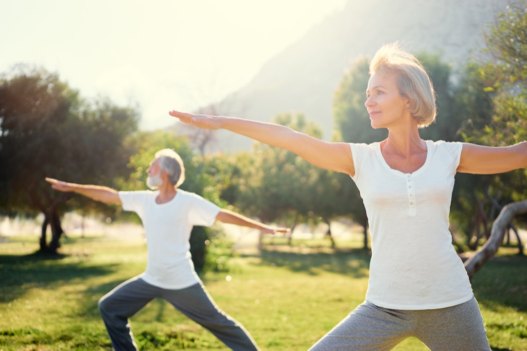 Older Couple Doing Yoga Energy After 40