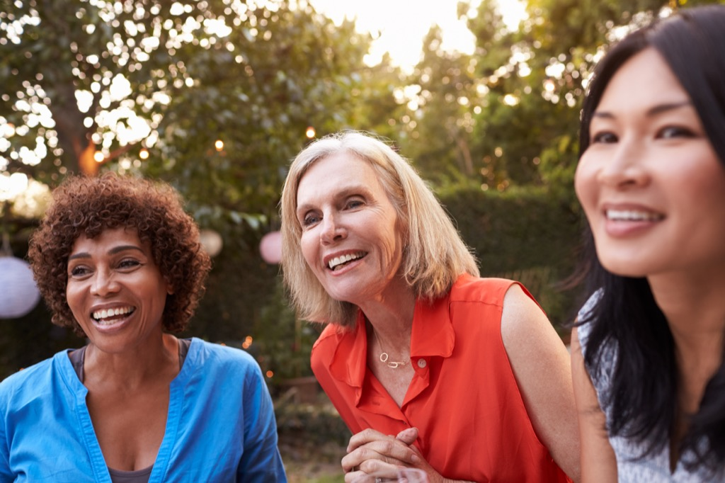 three women smiling outside, how to make friends after 40