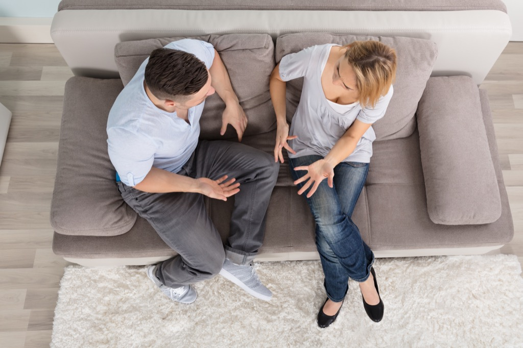 man woman chatting couch