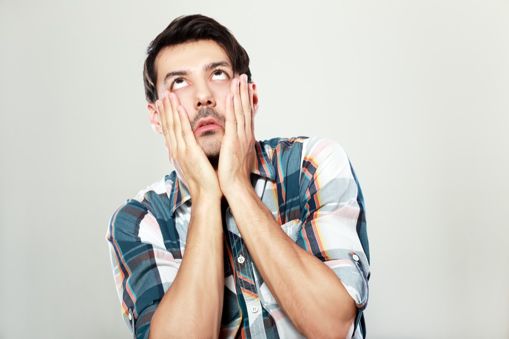 man rolling his eyes because of the worst dating phrases