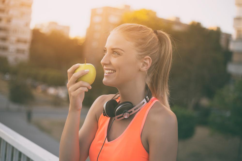 happy healthy woman eating apple.