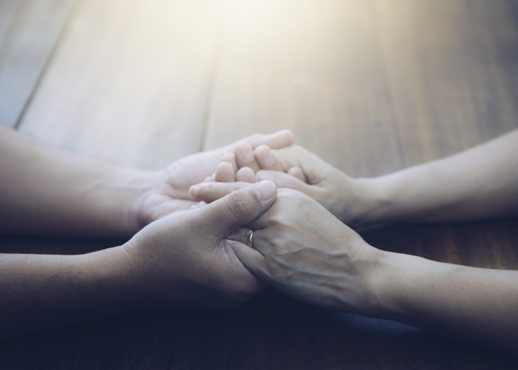 couple holding hands in gratitude and giving thanks together