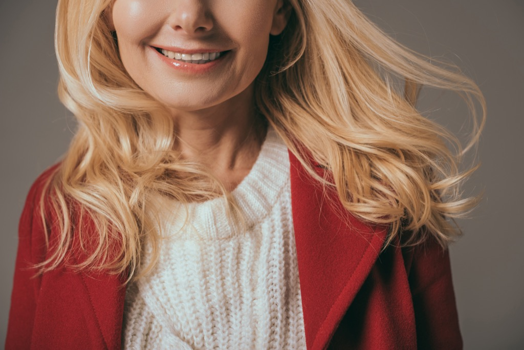 woman wearing a white sweater and red blazer - how to dress over 50