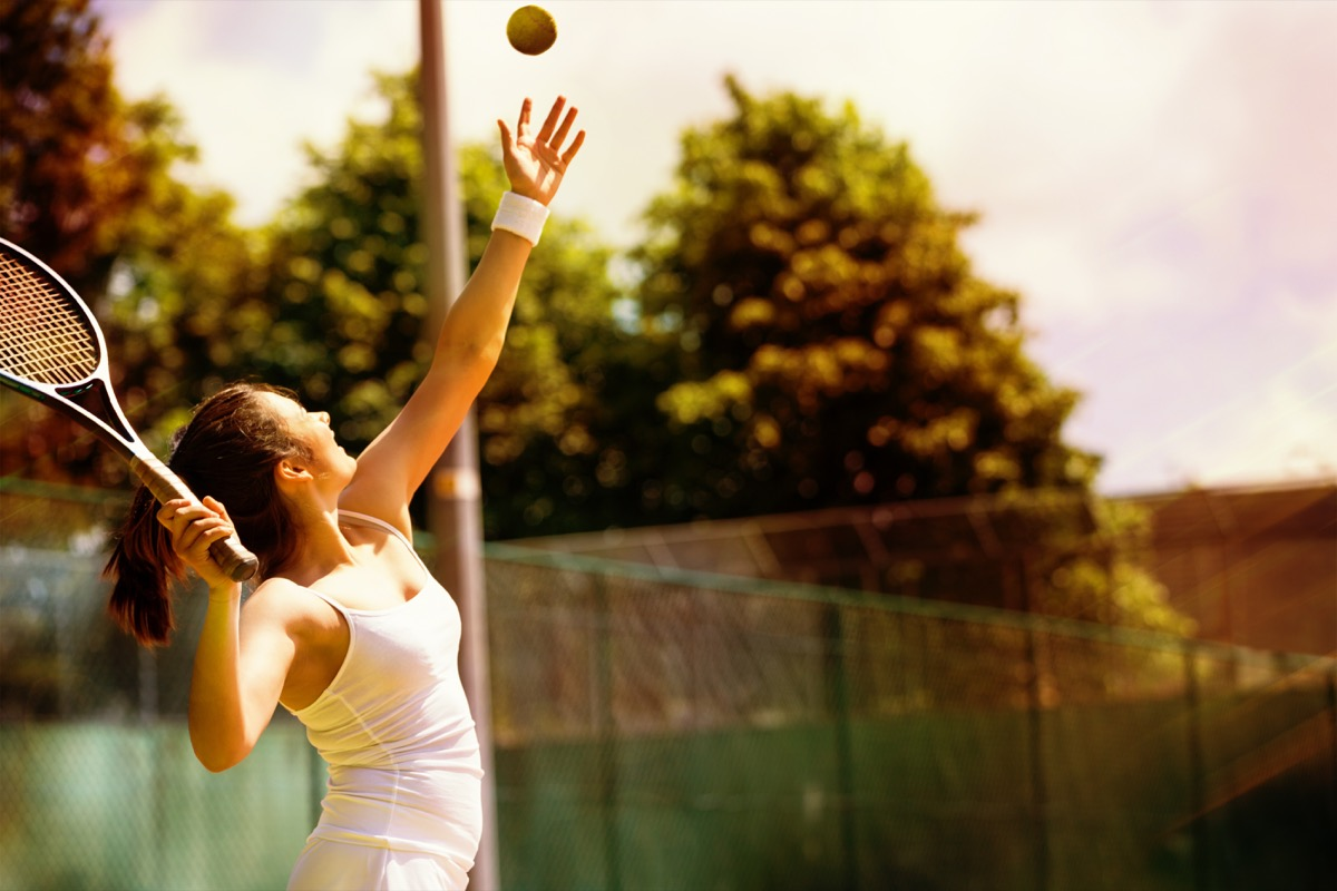 women serving a tennis ball, hiring manager tips