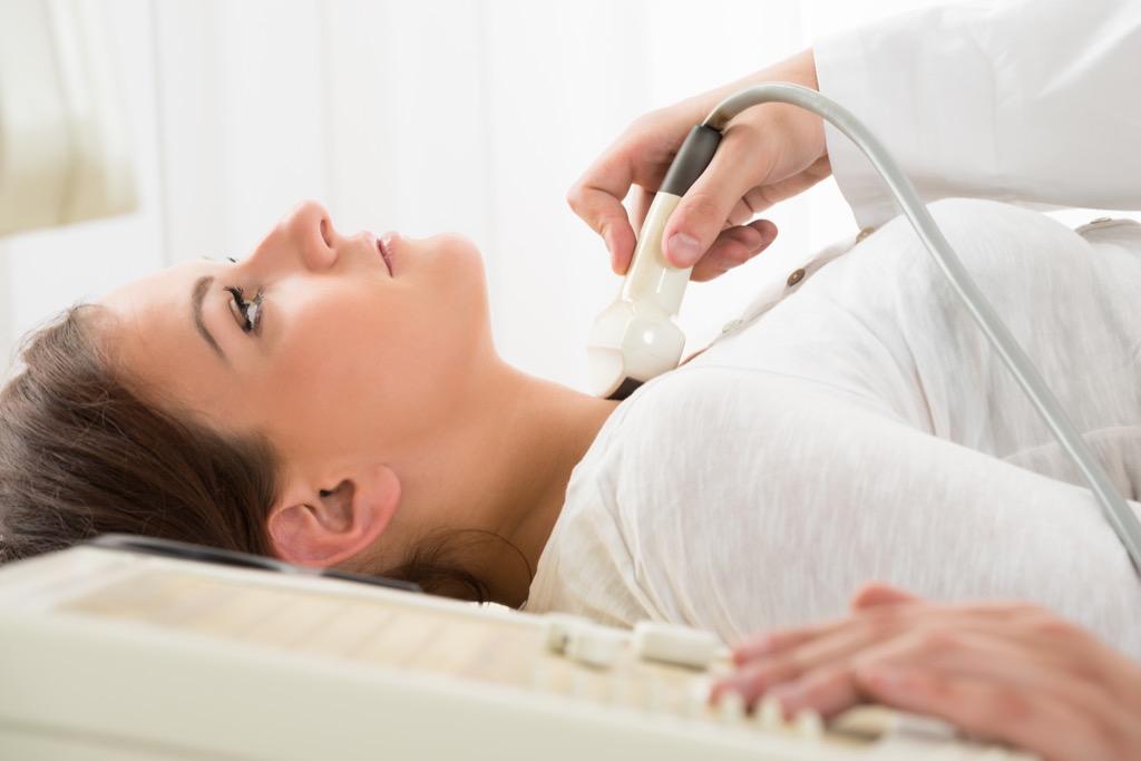 thyroid woman getting neck ultrasound