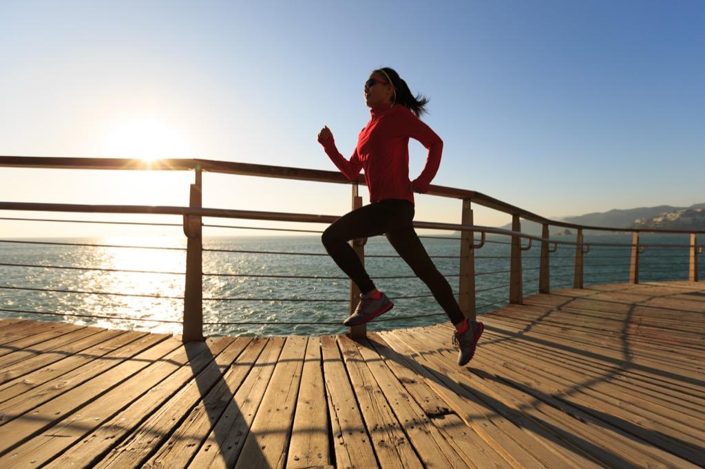 Woman running in sunshine