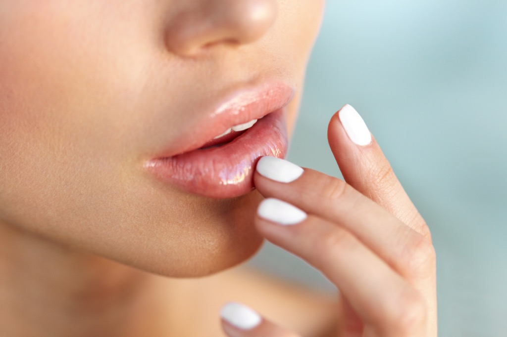 woman touching lips, makeup for older women