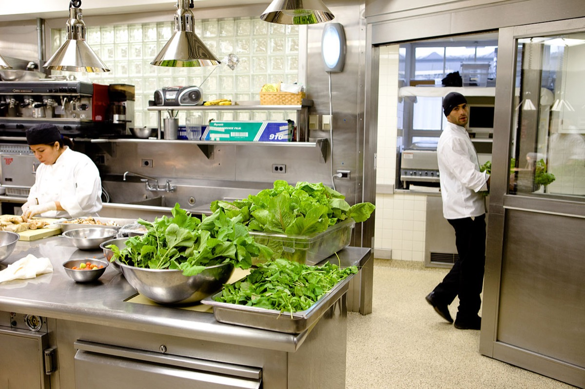 Radishes and lettuce harvested from the White House Garden are prepared for the Congressional Spouses Luncheon May 17, 2009.