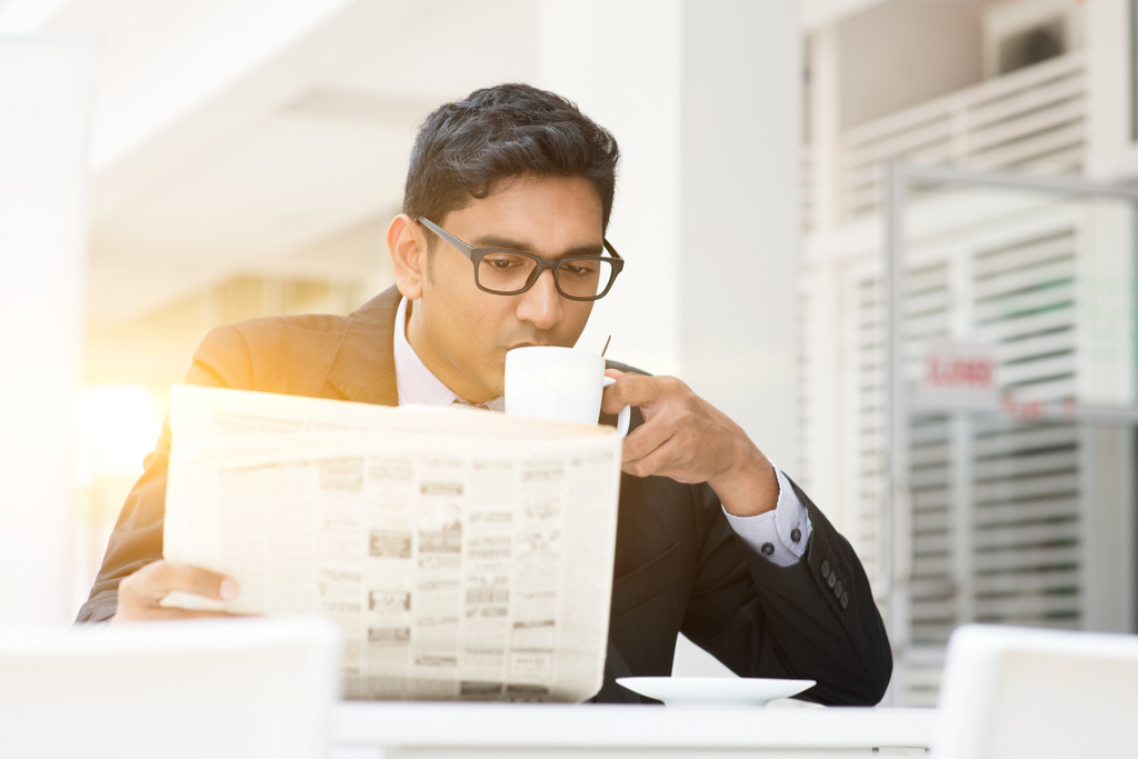 Businessman Reading Newspaper advice you should ignore over 40