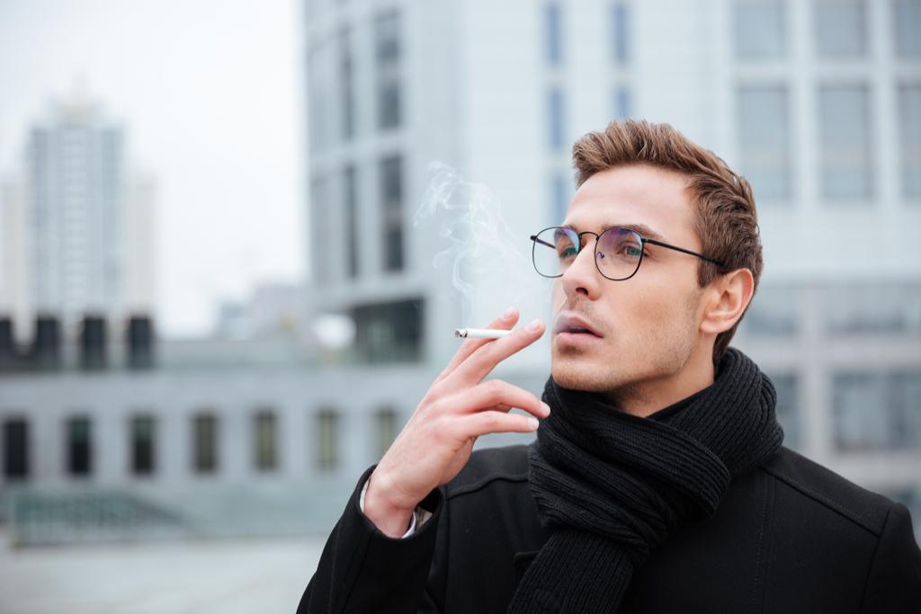 Businessman Smoking Regrets