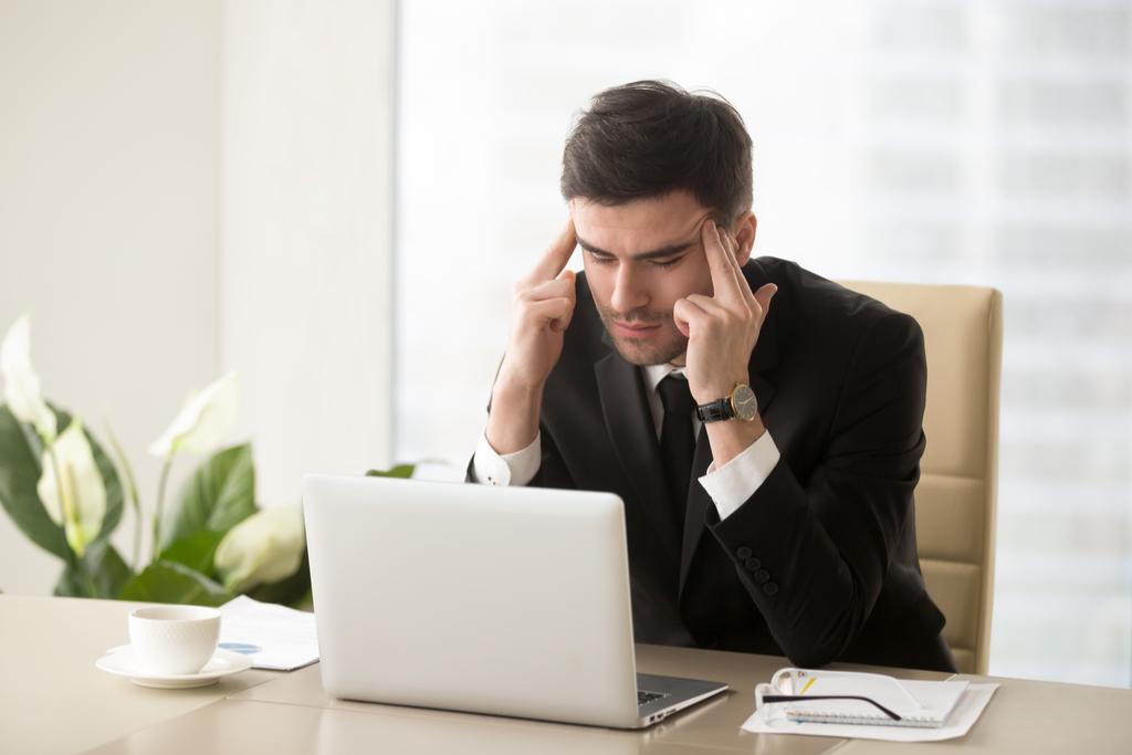 Businessman with Migraine