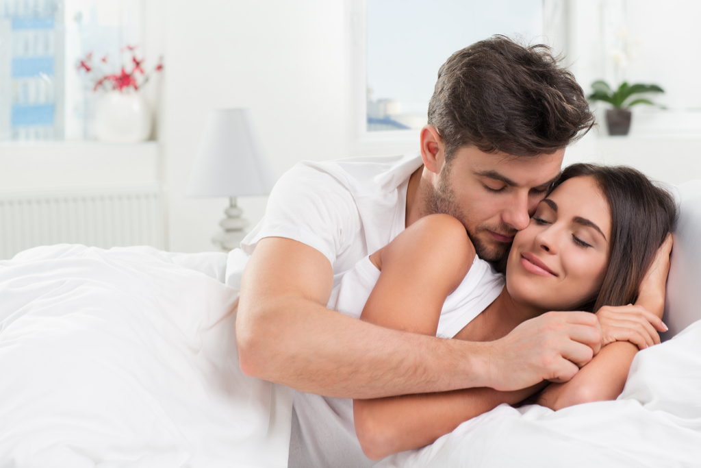 Couple Cuddling in Bed Romance