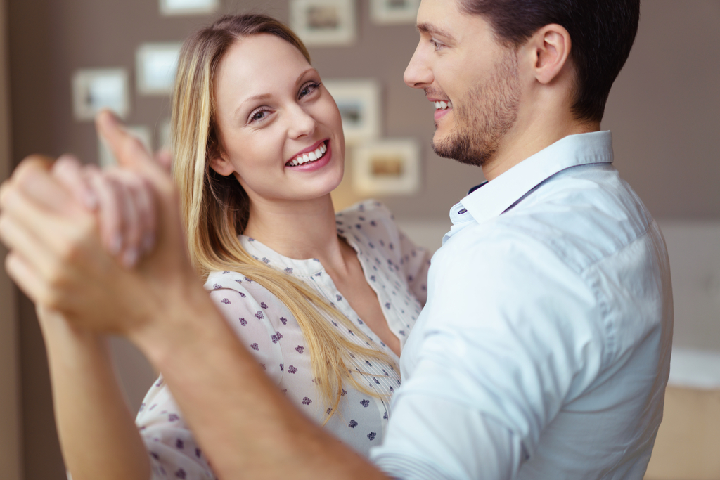 Couple Dancing at Home Romance