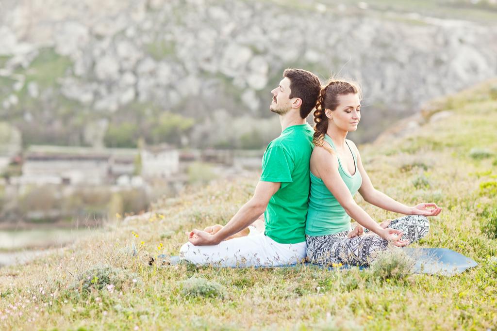 Couple Doing Yoga on Mountain Romance, Best Date Ideas