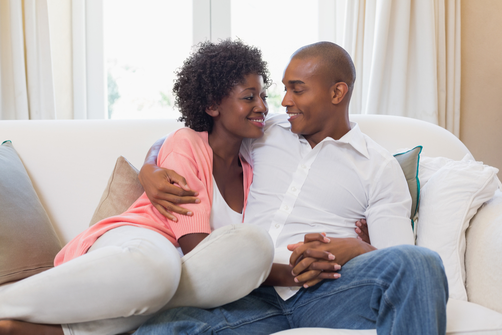 Couple Holding Hands on Couch Romance
