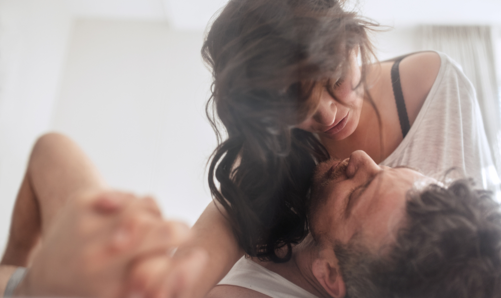Couple Making Eye Contact in Bed Romance kinkly