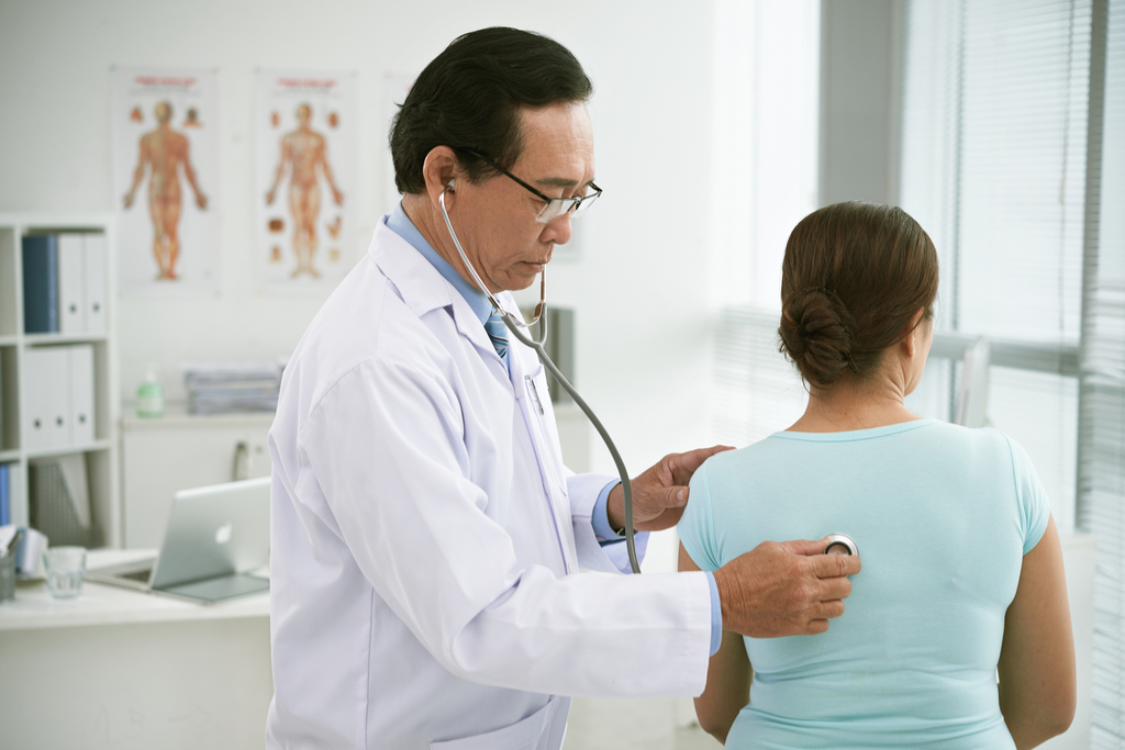 Doctor Checking Woman's Lungs