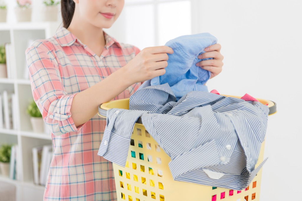 Woman doing laundry {Home Organization Tips}