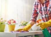 woman dusting countertop, new uses for cleaning products