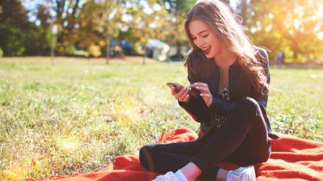 Girl Smiling at Phone Romance