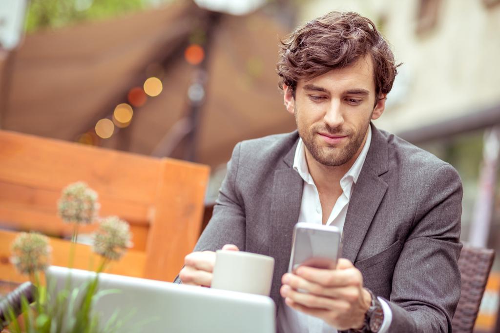 Guy on Phone Smiling Romance