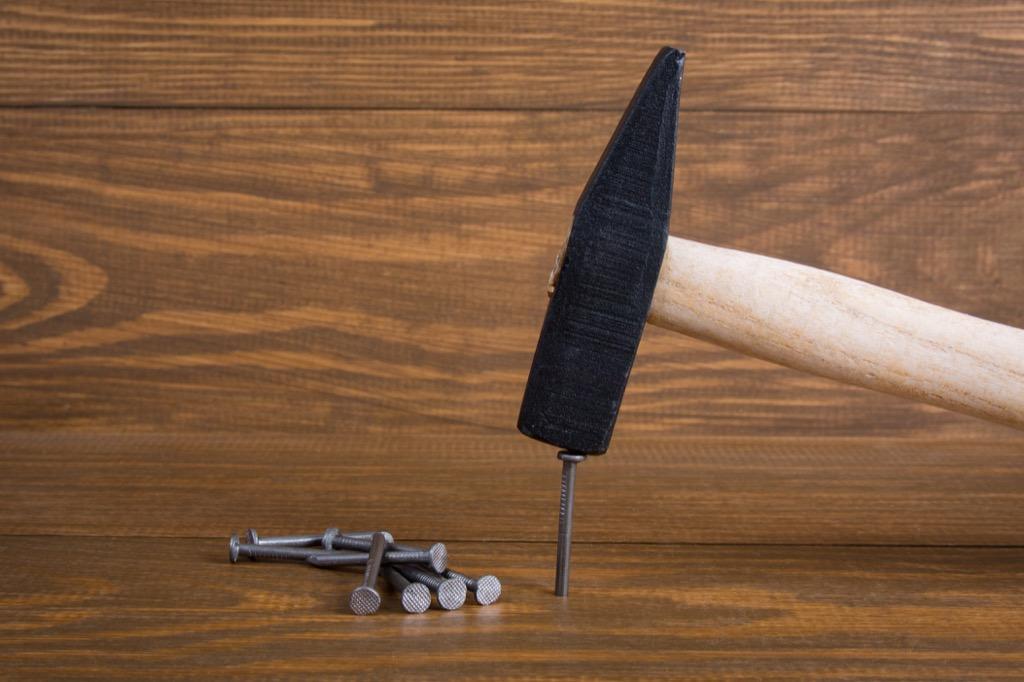A Hammer Nailing In a Nail
